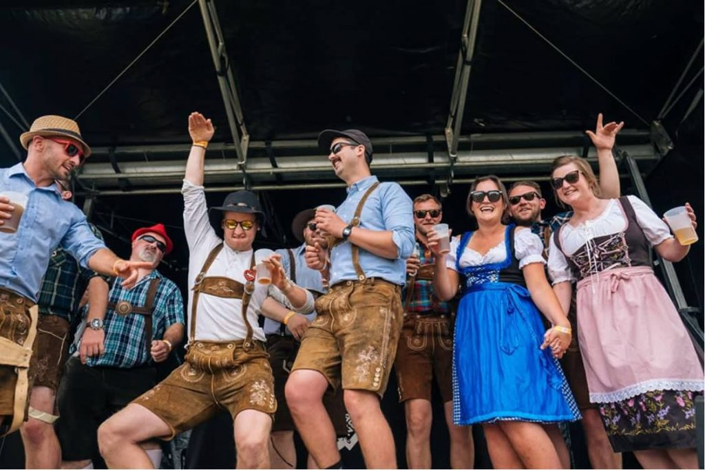 people dancing in traditional clothing at Wanaka Beer Festival